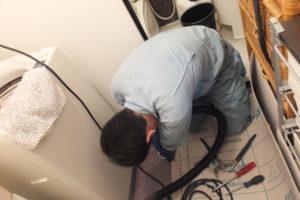 洗濯機配管掃除中